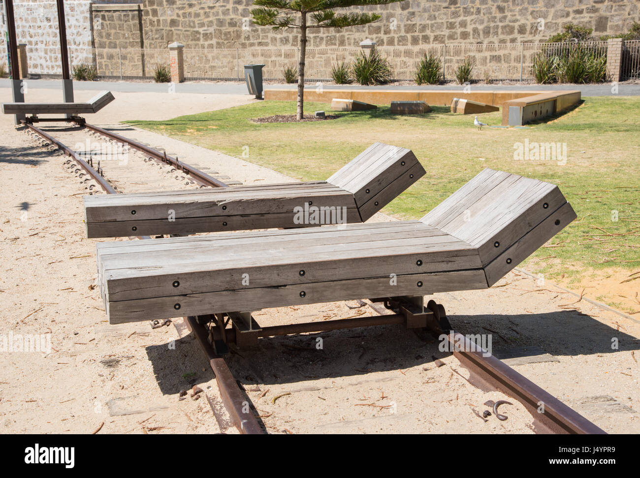 Amazing Two Wooden Lounge Chairs On Railway Tracks Over Sand In Ibusinesslaw Wood Chair Design Ideas Ibusinesslaworg