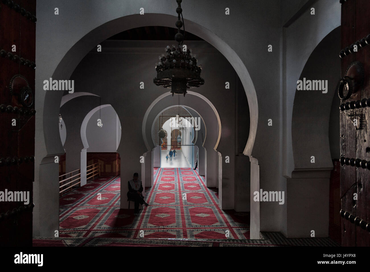FEZ, MOROCCO - FEBRUARY 18, 2017: Unidentified people in the Mosque Qaraouiyine in the medina of Fez, Morocco - Stock Image