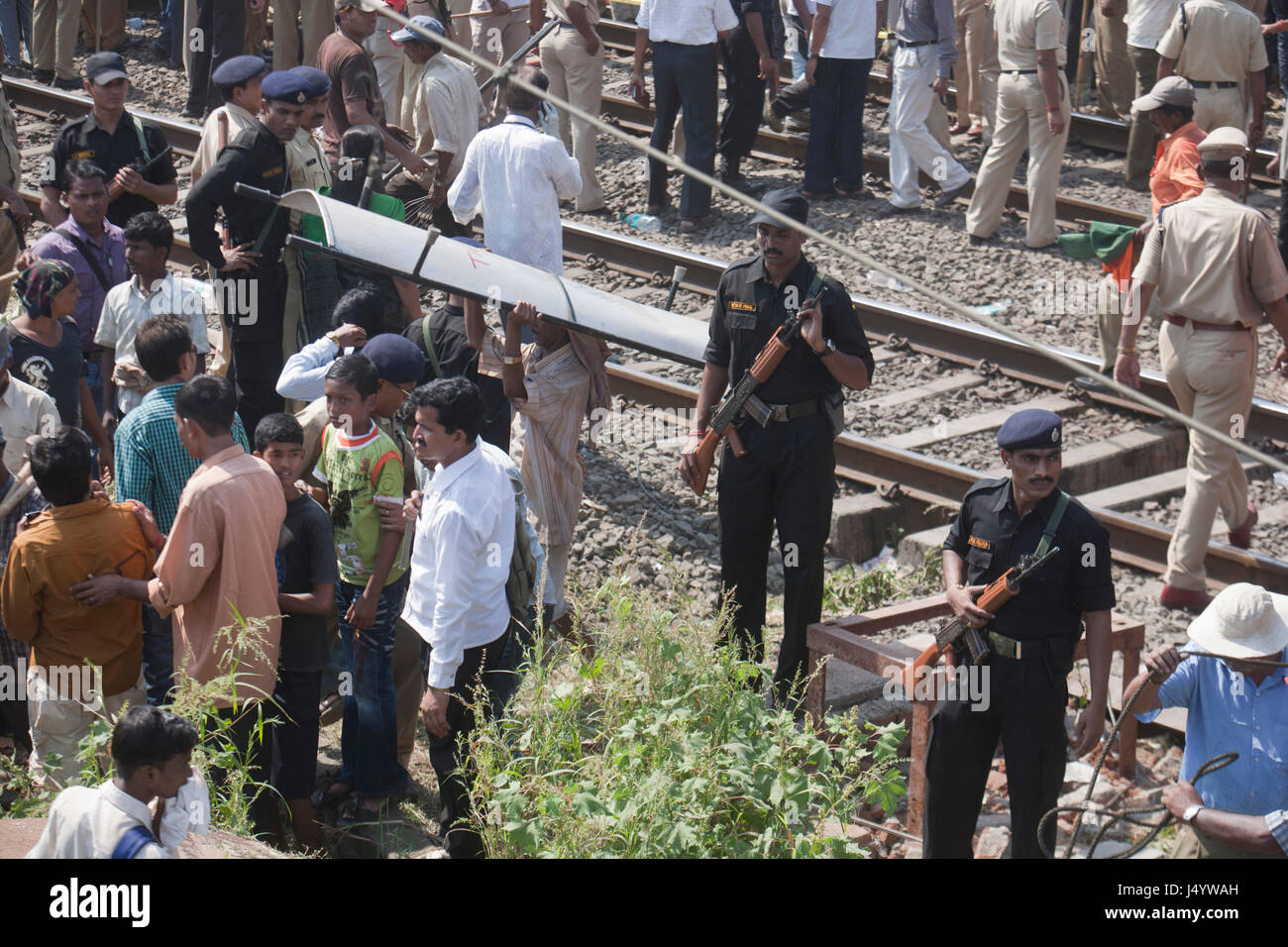 Security forces deployed water pipeline collapse over train, thane, maharashtra, india, asia - Stock Image