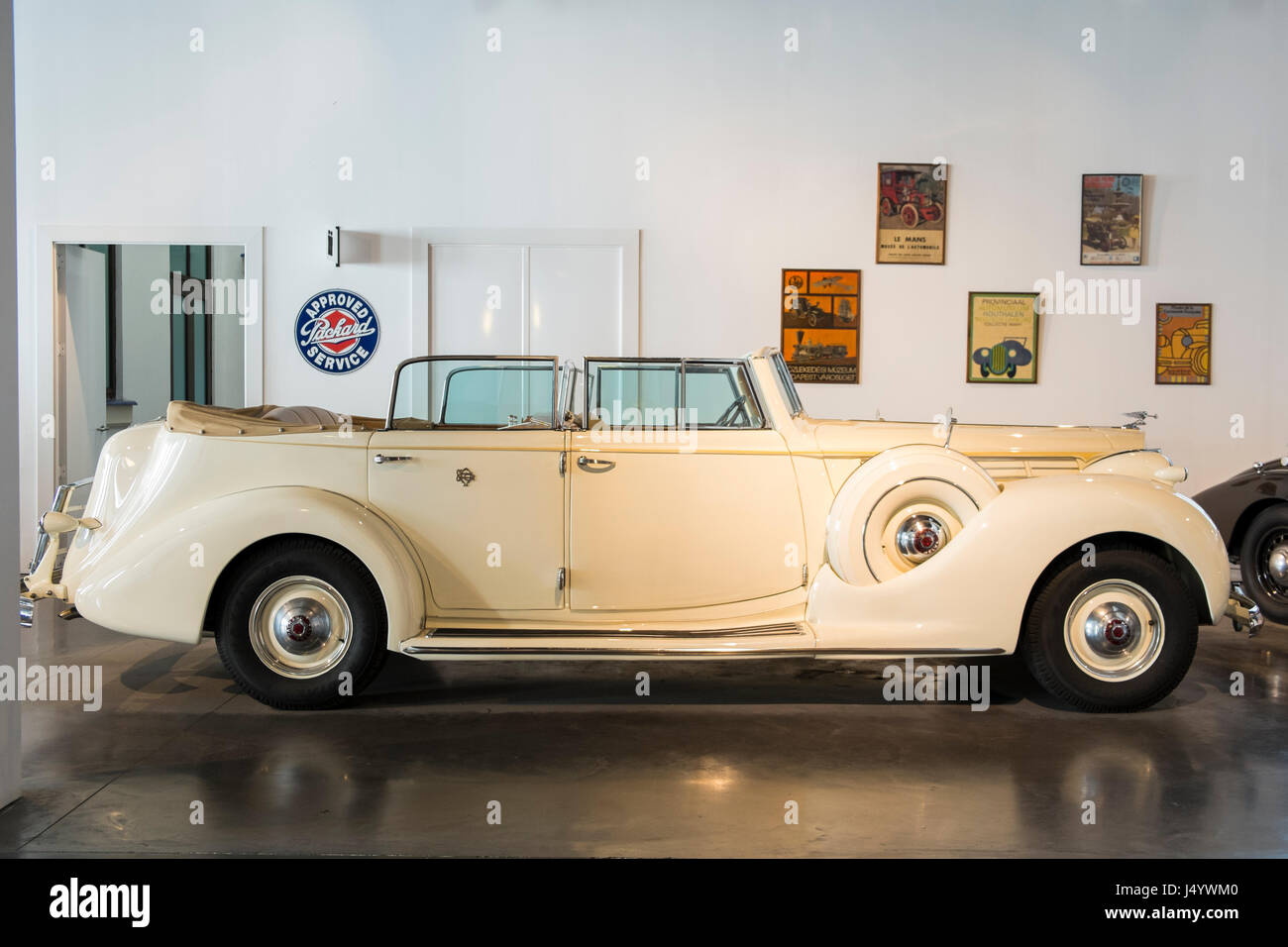 1939 Packard Twelve Armored Convertible Sedan by Dietrich. Automobile museum of Málaga, Andalusia, Spain. - Stock Image