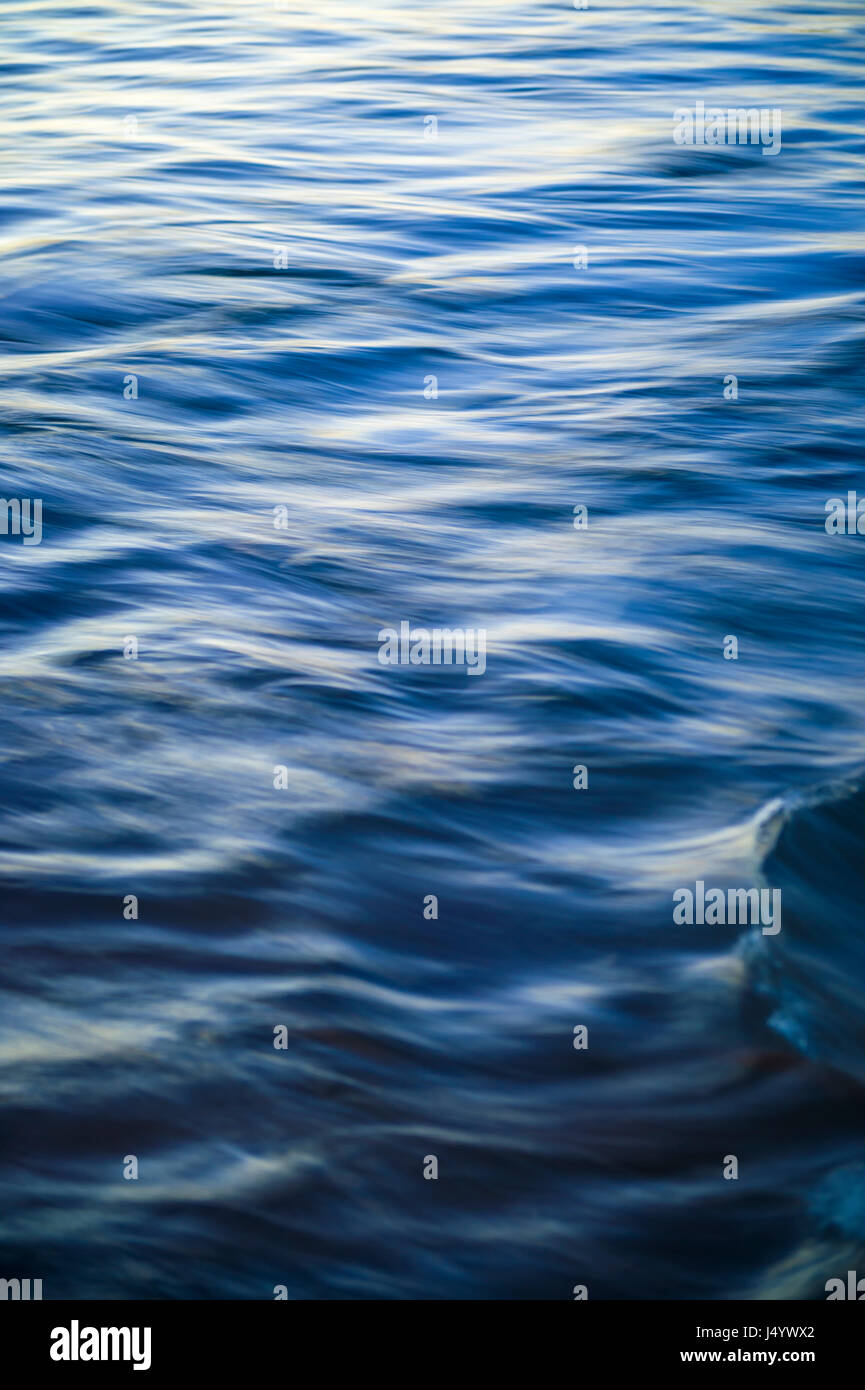 Abstract motion blur background of the ripple surface of the blue ocean. Slow shutter speed; motion blur - Stock Image