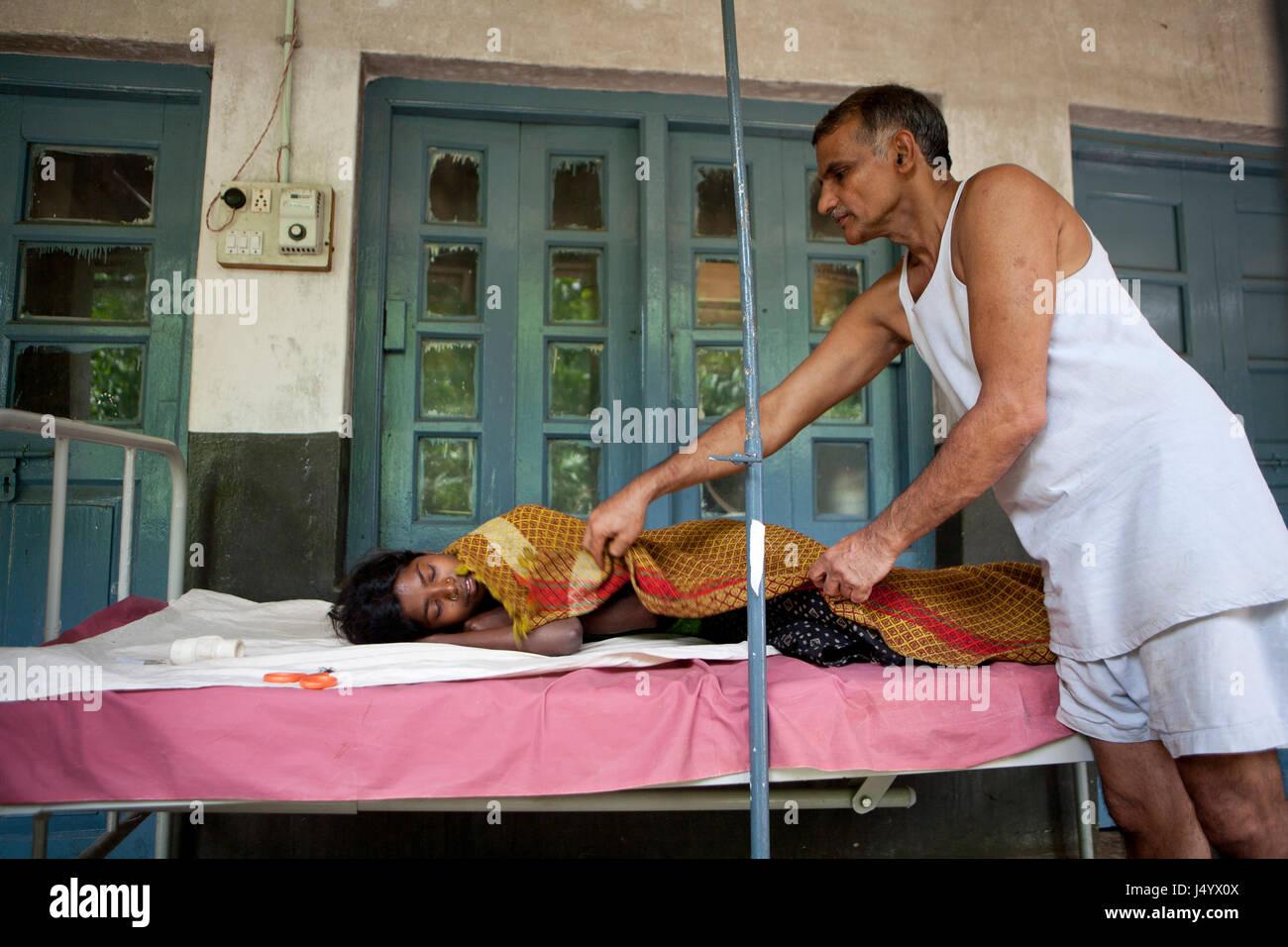 Dr prakash baba amte take care of patient, maharashtra, india, asia - Stock Image