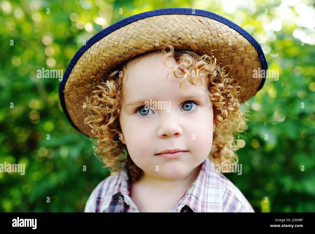8d55d7768 portrait of curly red-haired baby in a hat Stock Photo: 140756554 ...