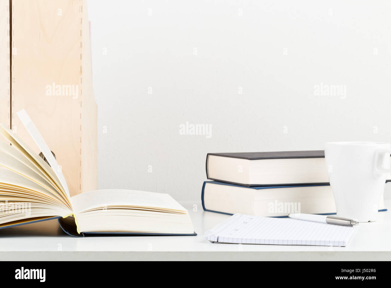 Strange White Office Desk With Books Notepad And Cup Study Or Interior Design Ideas Clesiryabchikinfo