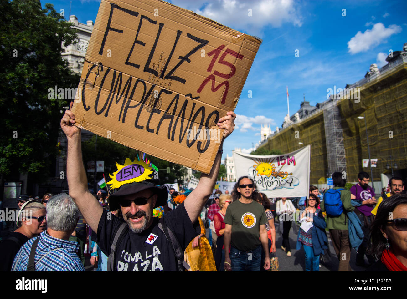 """Madrid, Spain. 14th May, 2017. A man with a placard that reads """"Happy birthday 15M"""" during a demonstration for the Stock Photo"""