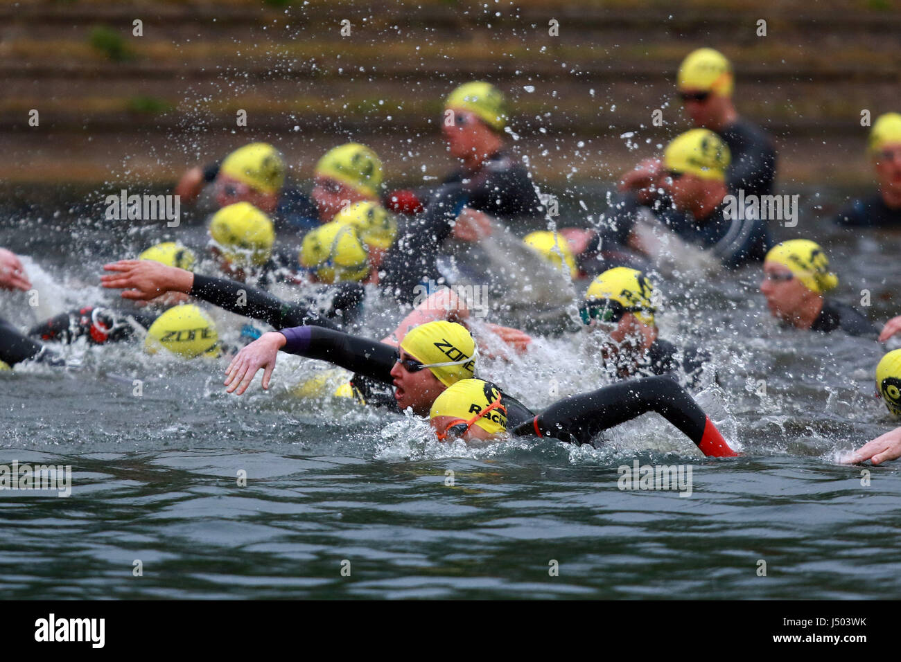 Peterborough, Cambridgeshire, UK. 13th May, 2017. Competitors in the Monster Mojito Triathlon start the race swimming - Stock Image