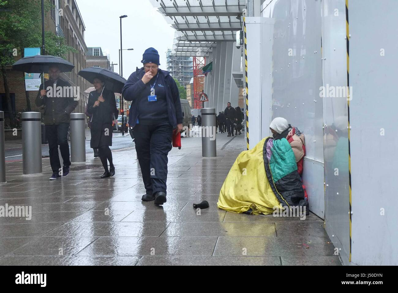 London, UK. 15th May, 2017. Homeless man next to The Shard at London Bridge station. :Credit claire doherty Alamy/Live Stock Photo
