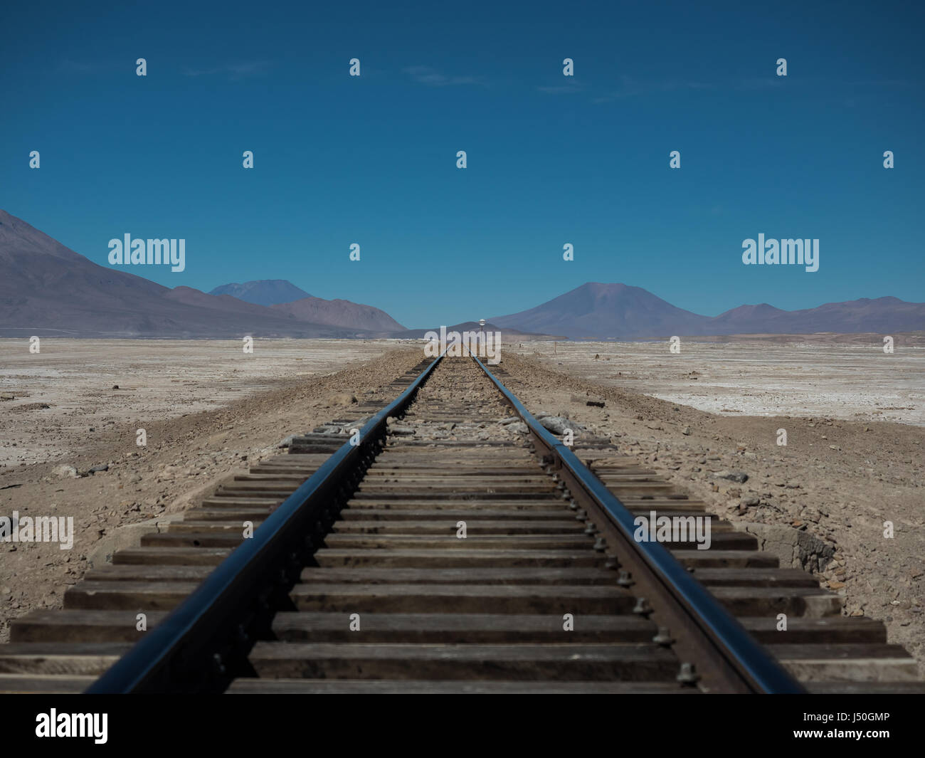 Straight railway through Atacama Desert, near Uyuni Salt Flats, Bolivia, South America. - Stock Image