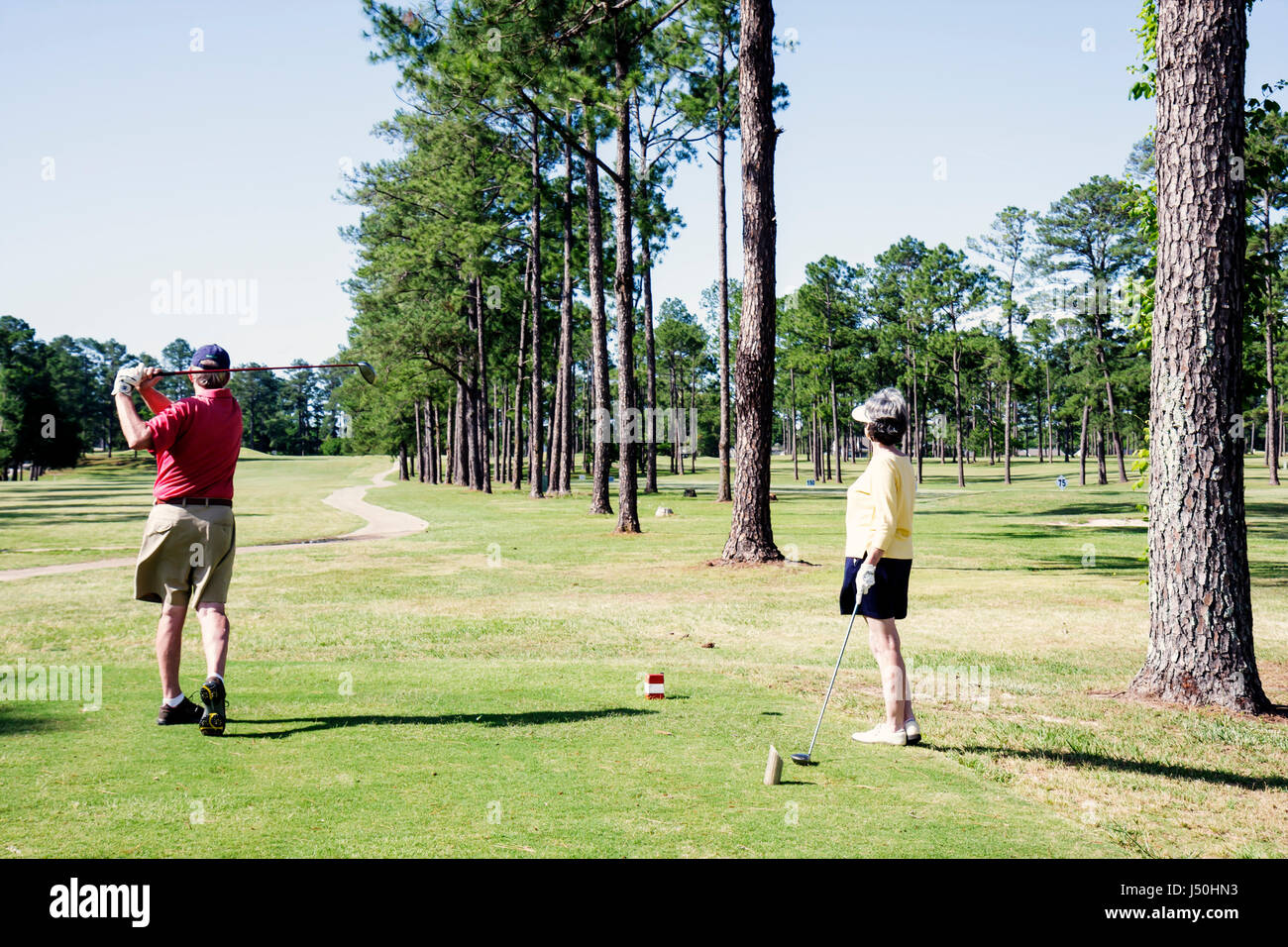 Monroeville Alabama Vanity Fair Golf and Tennis Club man woman tee off green fairway sport game recreation - Stock Image