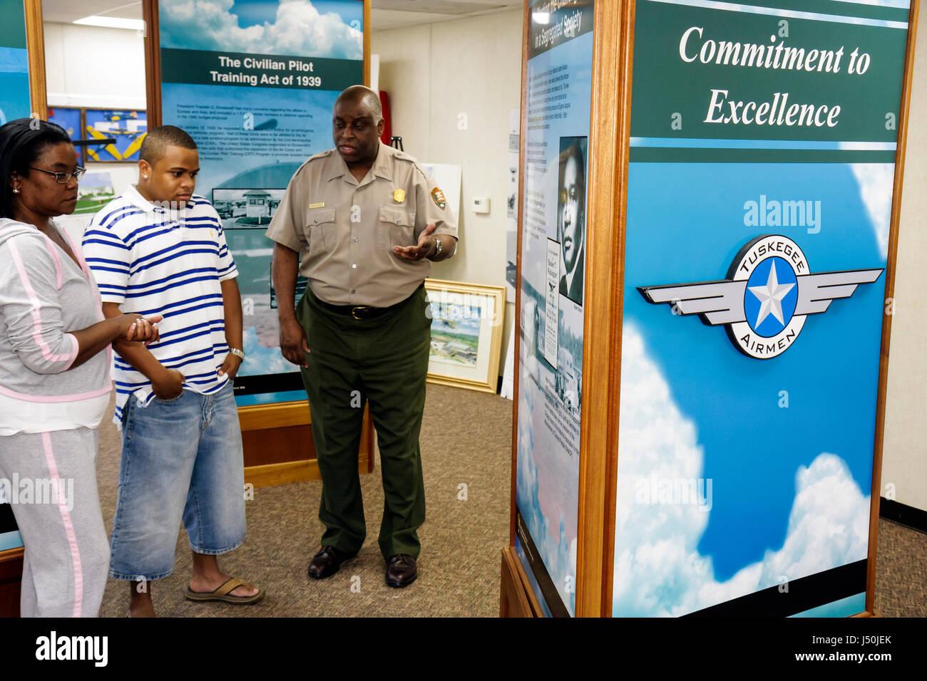 Alabama Tuskegee Black History Moton Airfield Tuskegee Airmen National Historic Site Black man guide ranger woman - Stock Image
