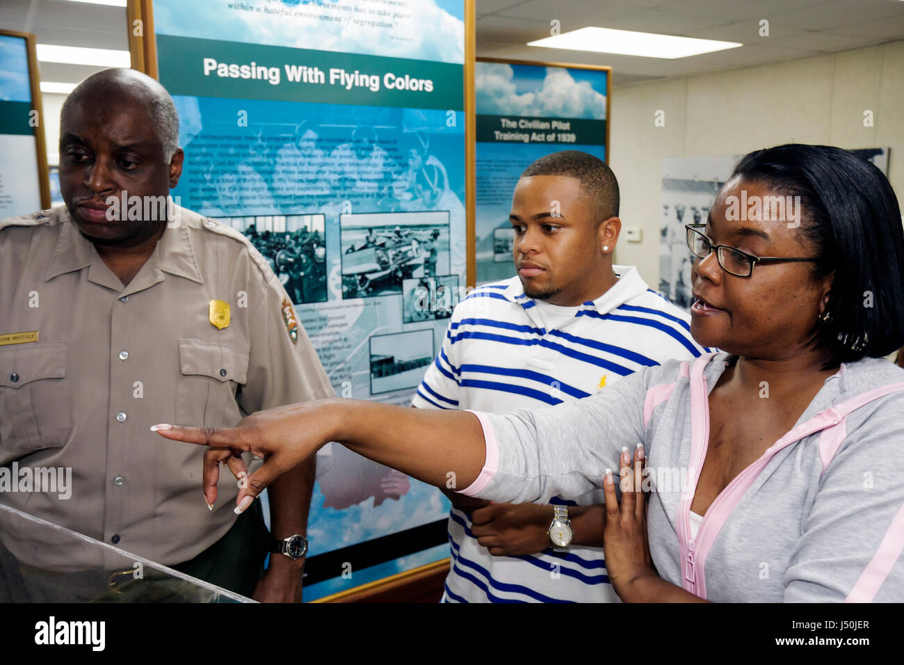 Alabama Tuskegee Black History Moton Airfield Tuskegee Airmen National Historic Site Black man tour guide woman - Stock Image