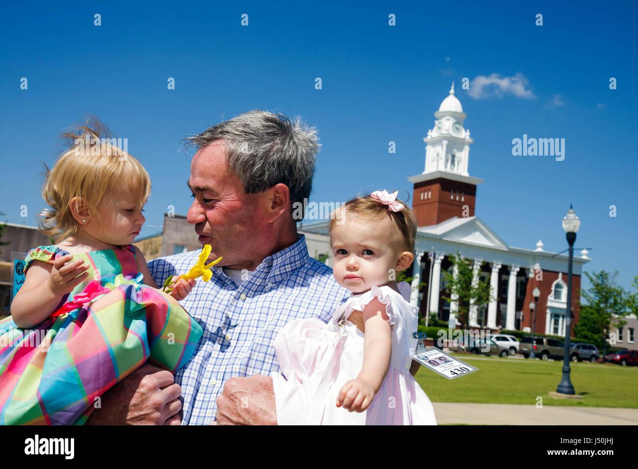 Alabama Opelika Historic District Lee County Courthouse 1896 man baby girl toddler grandfather Corinthian column - Stock Image