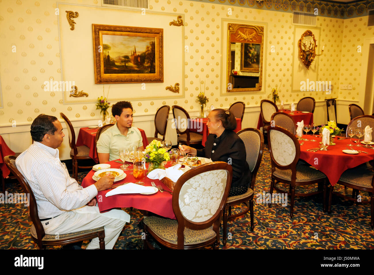 Selma Alabama St. James Hotel restaurant dining room Black family man woman father mother son student table - Stock Image