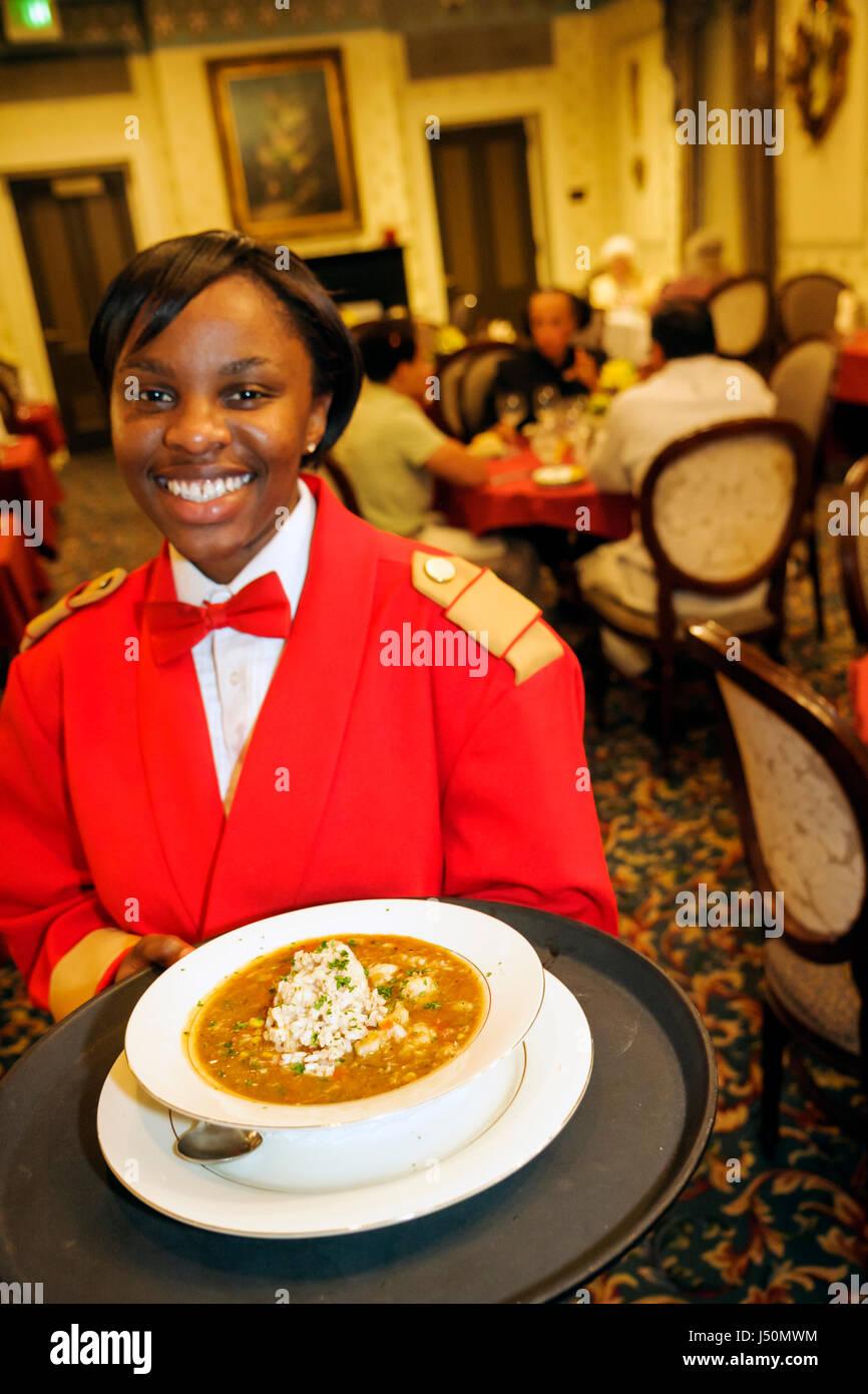 Selma Alabama St. James Hotel Black female student waitress employee serving gumbo - Stock Image
