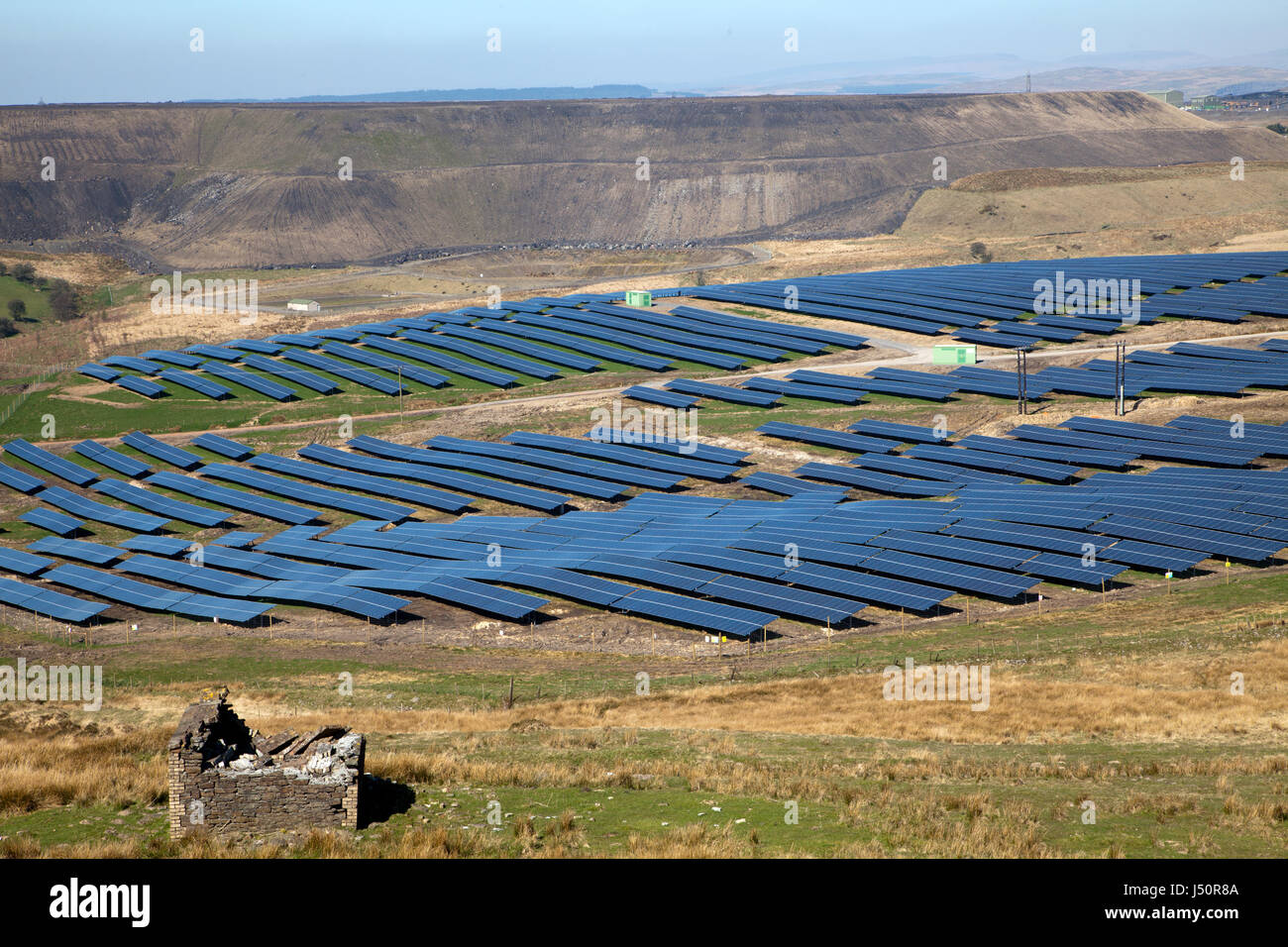 SolarPark next to Opencast coal mine showing clean green energy of solar power contrasting with destructive open Stock Photo