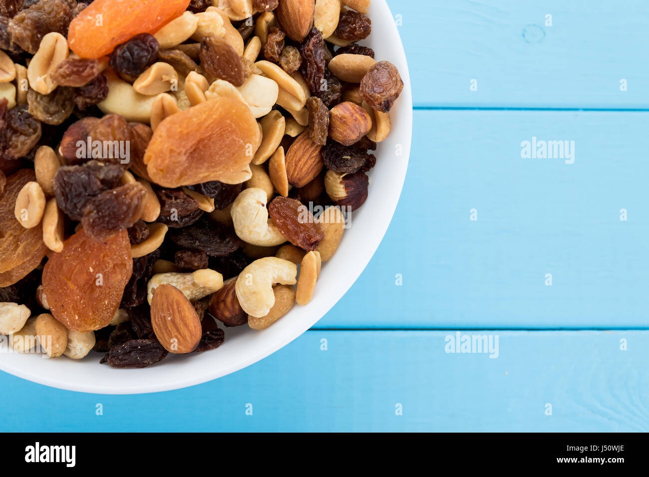 Assorted nuts and dry fruit in white bowl - Stock Image
