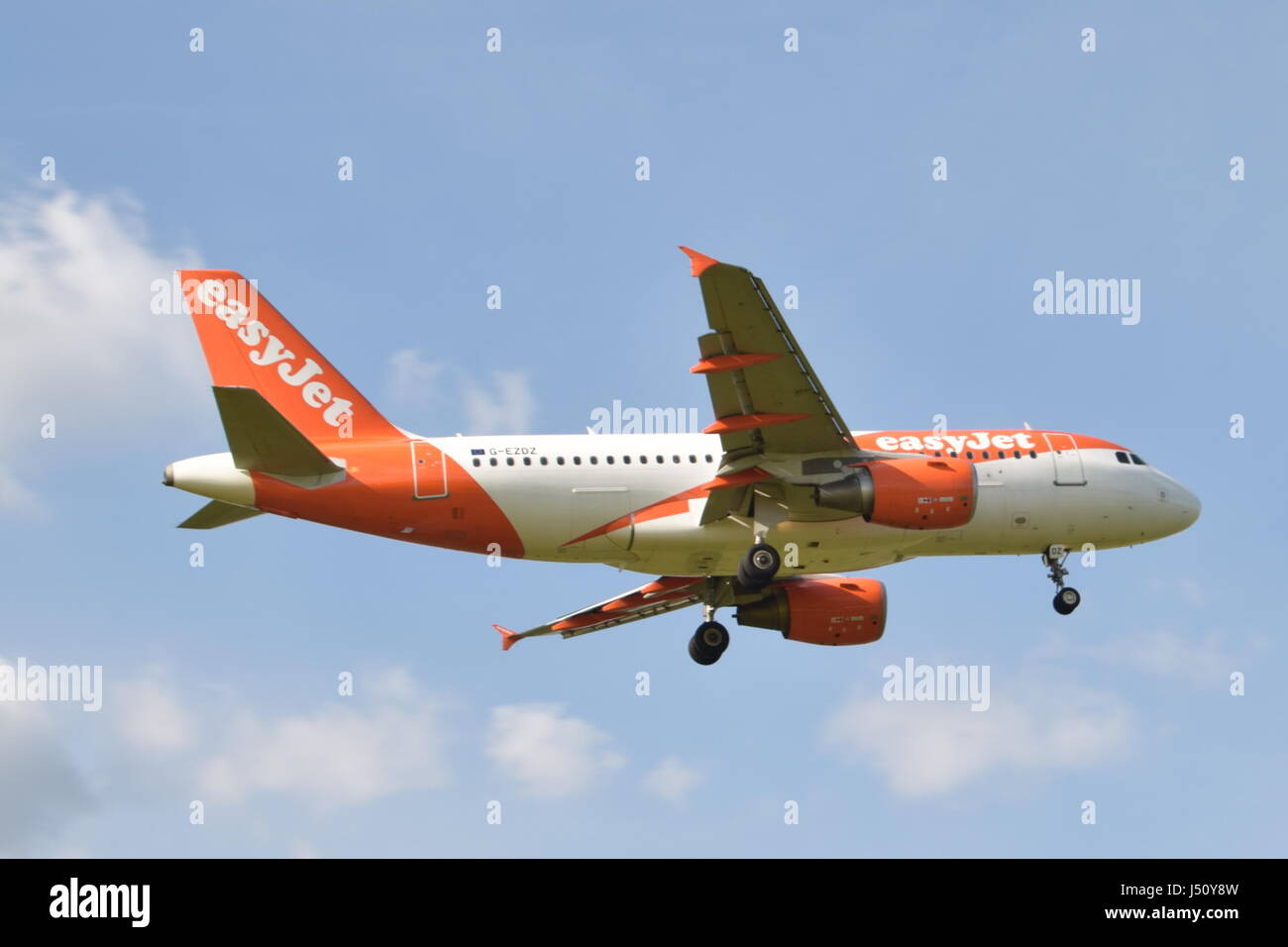 G-EZDZ easyJet Airbus A319-100 - cn 3774 on final approach to London Gatwick airport LGW - Stock Image