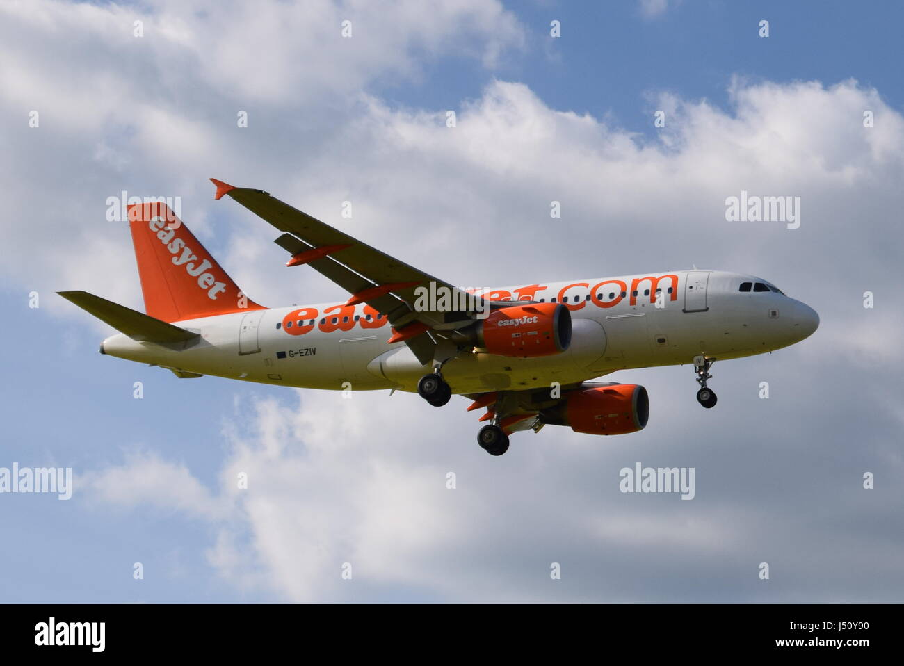 G-EZIV easyJet Airbus A319-100 - cn 2565 on final approach to LGW London Gatwick airport - Stock Image
