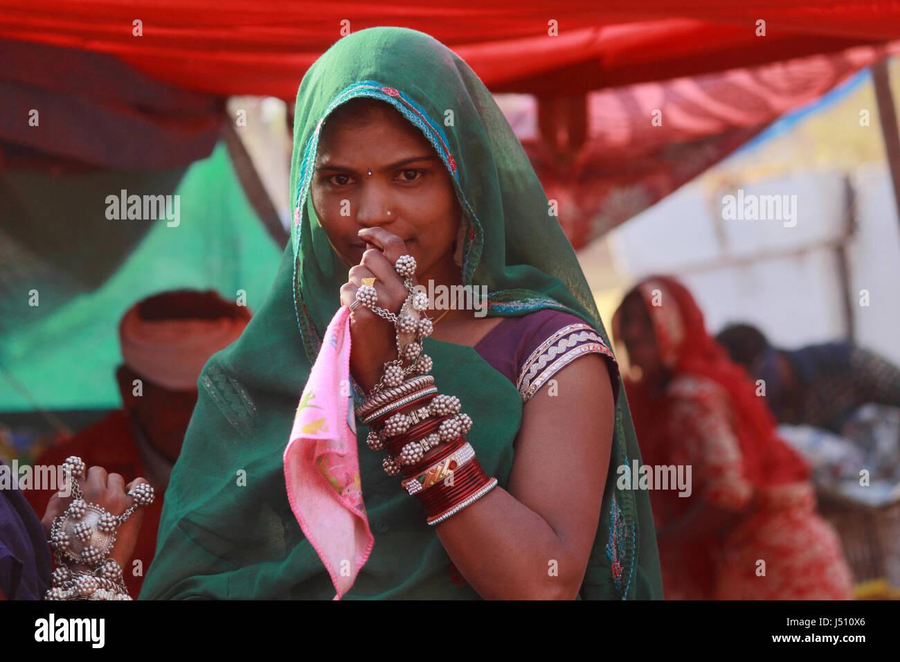 Woman in traditional attire. Kawant Festival, Gujarat, India - Stock Image