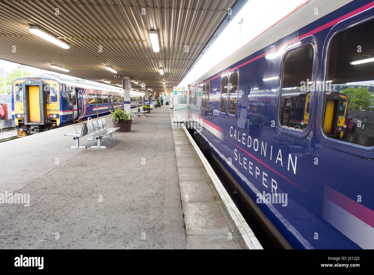 Fort William, Scotland - May 16, 2016: The Caledonian Sleeper train awaits departure from Fort William station for Stock Photo