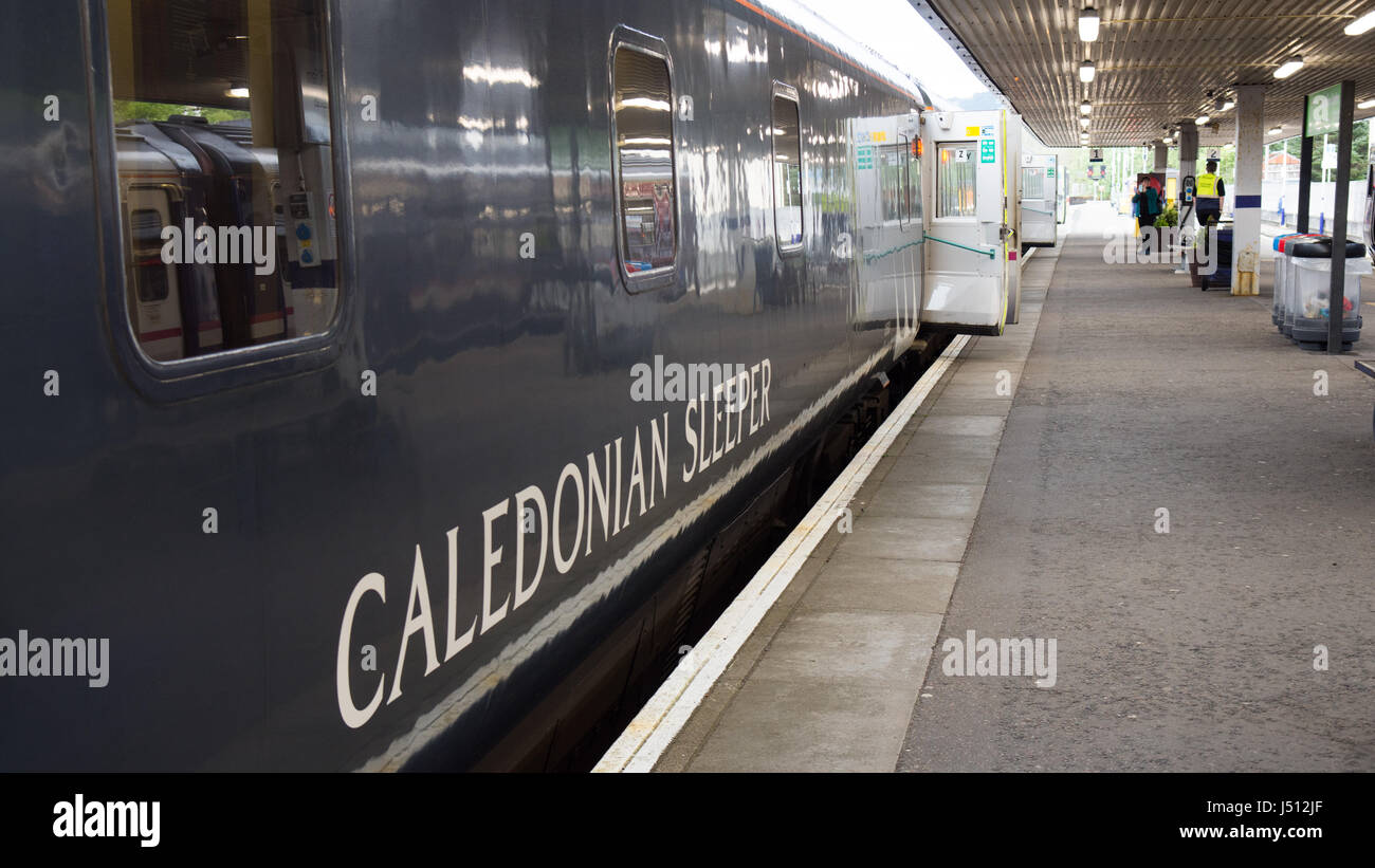 Fort William, Scotland - May 16, 2016: The Caledonian Sleeper train awaits departure from Fort William station for - Stock Image
