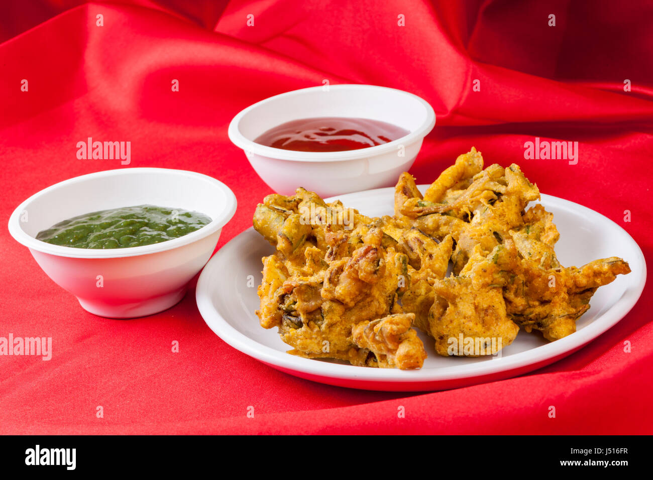 Onion Pakore served with green chatni - Stock Image