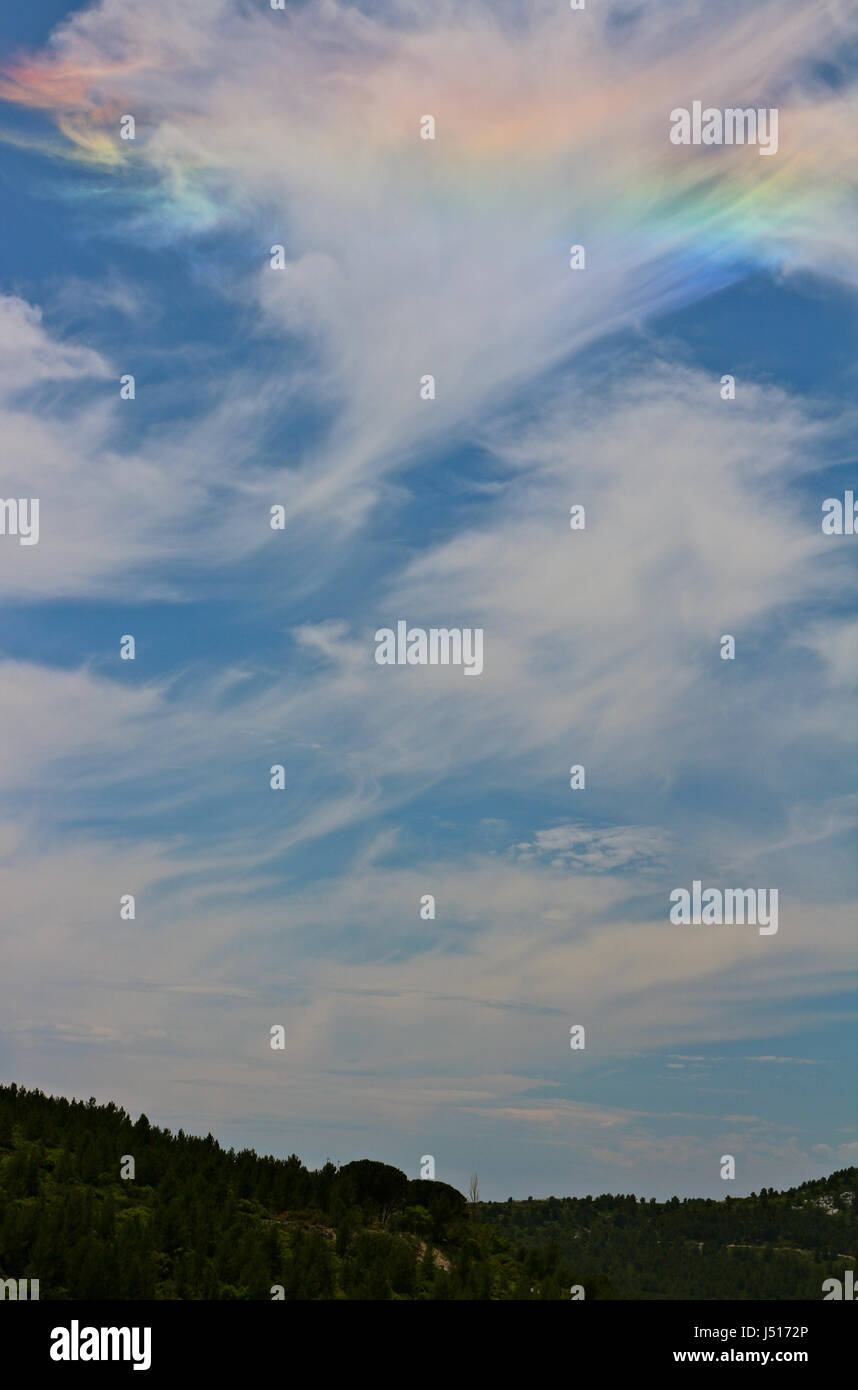 Irisation of clouds in a blue sky - Stock Image