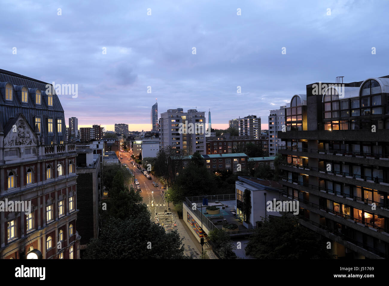 Aerial view over Golden Lane and Barbican Estate flats at night with thick cloud cover and lit up street below springtime - Stock Image