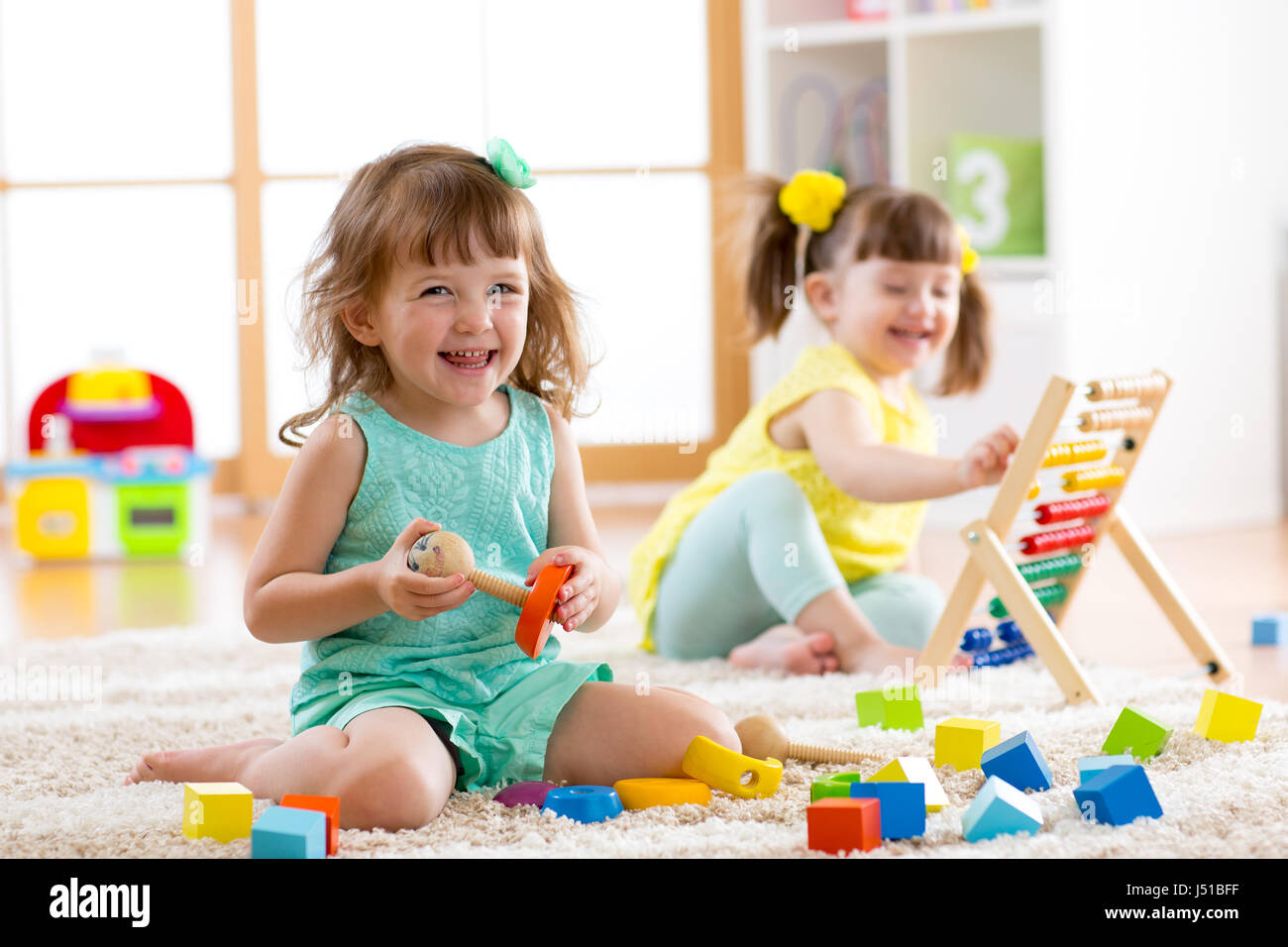 Kinder Garden: Little Kids Playing With Abacus And Constructor Toys On