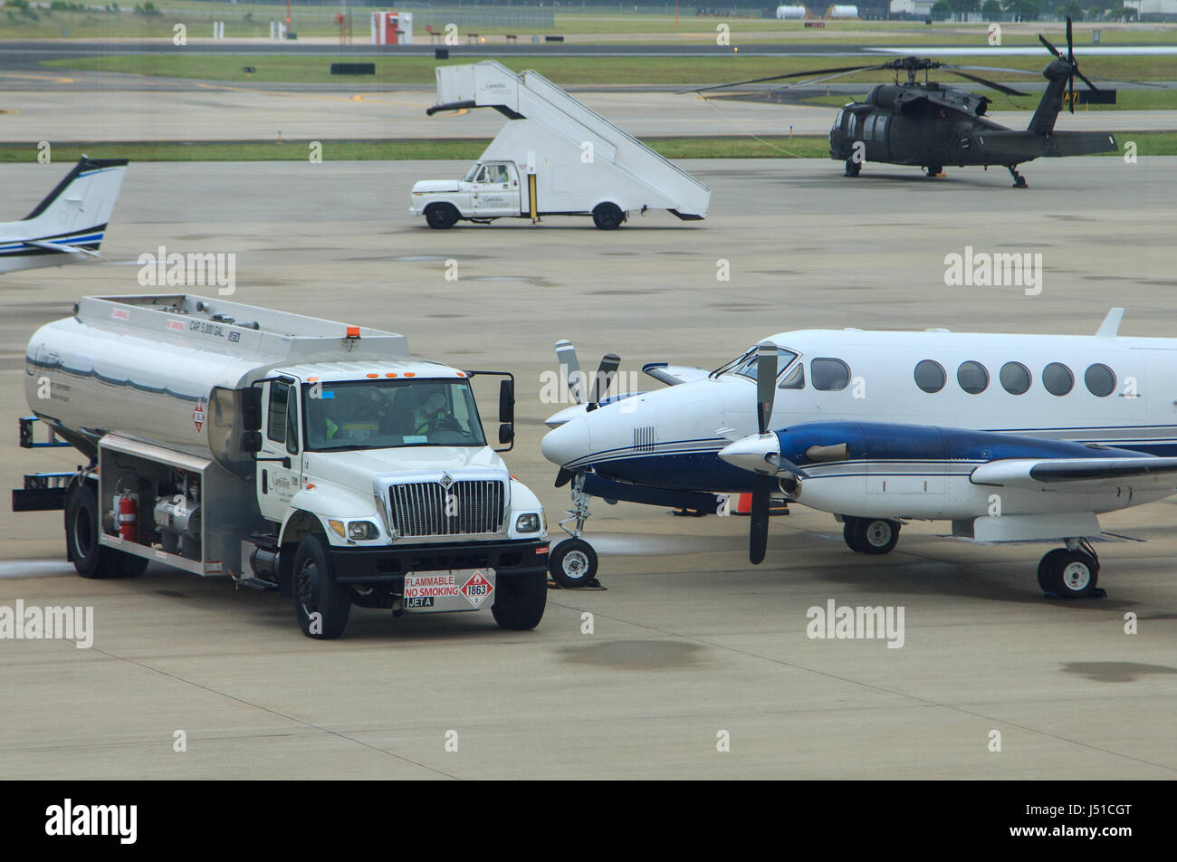 fuel truck and private plane on tarmac at general aviation terminal raleigh durham international airport - Stock Image