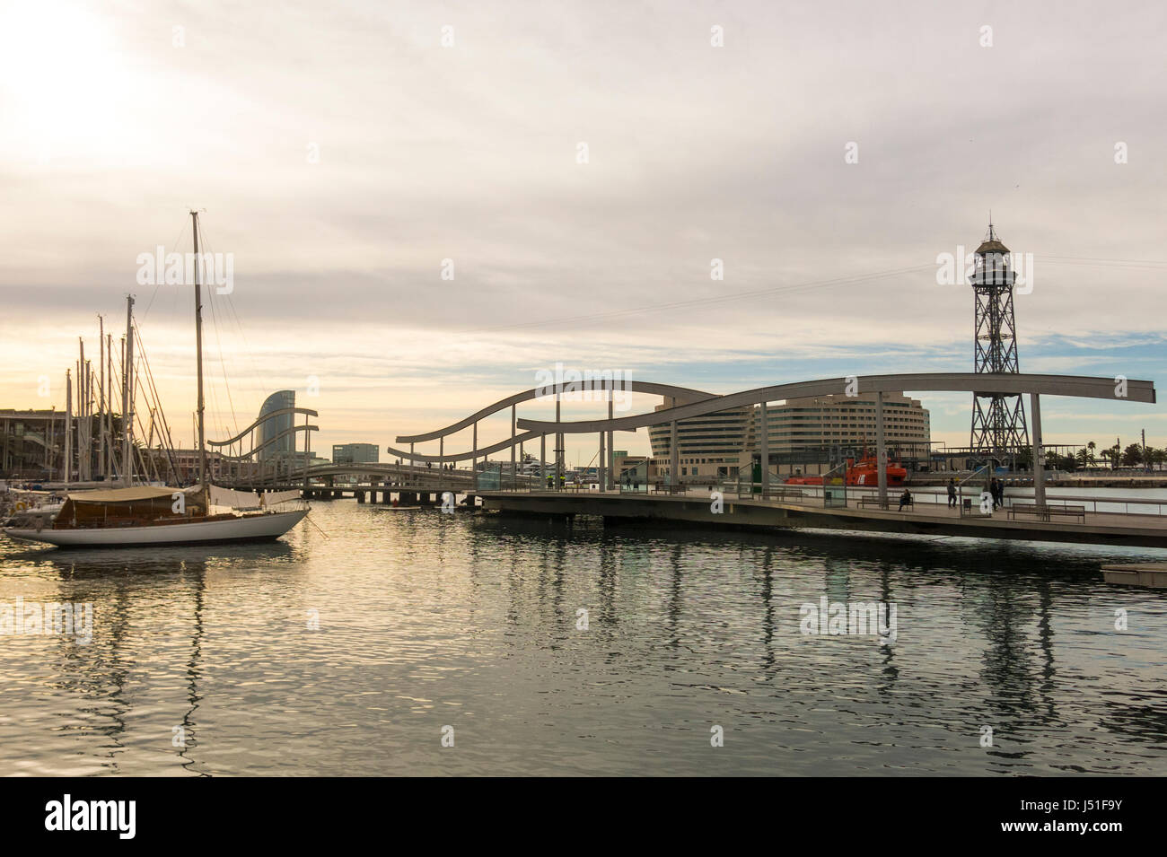 Sunrise at the port of Barcelona, at the end of the Ramblas. In the photo, the Ramblas on the sea, the World trade - Stock Image
