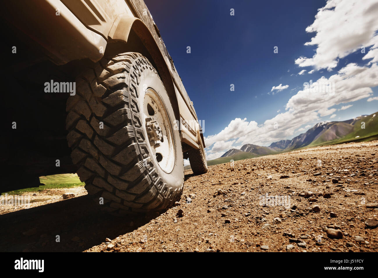 Big offroad car wheel on country road - Stock Image