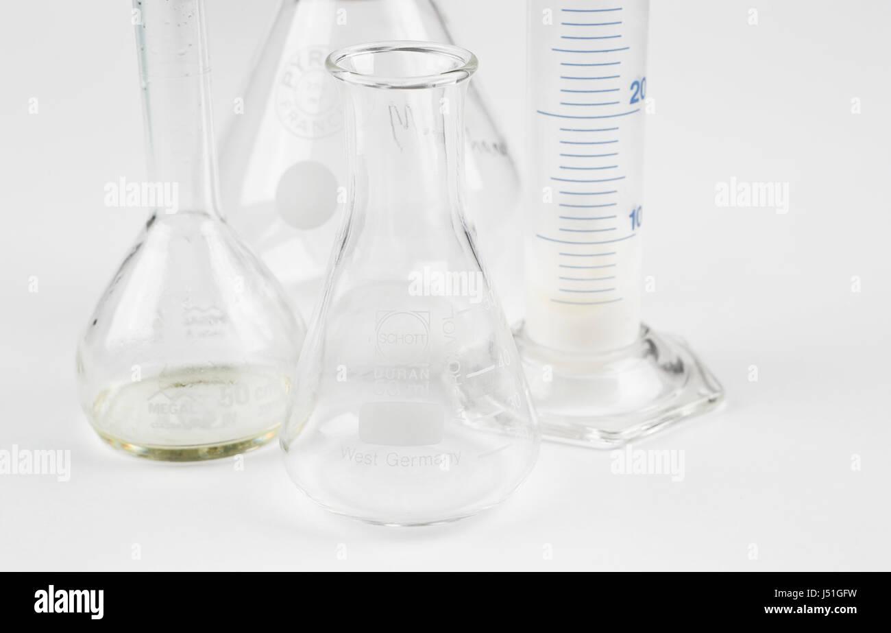 Laboratory bottles on white Stock Photo