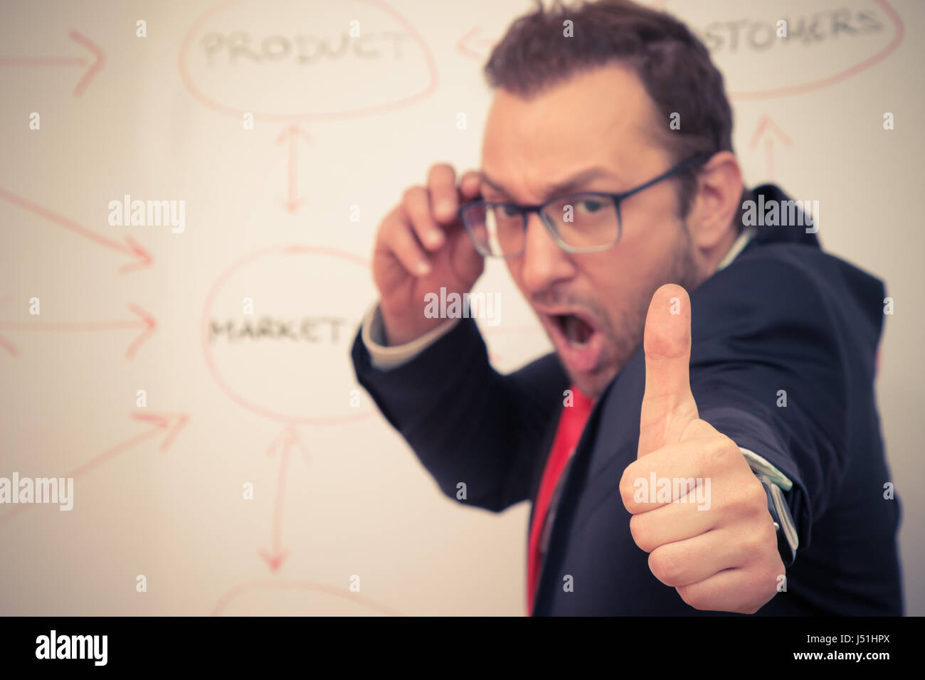 Businessman showing ok sigh with his thumb. Stock Photo