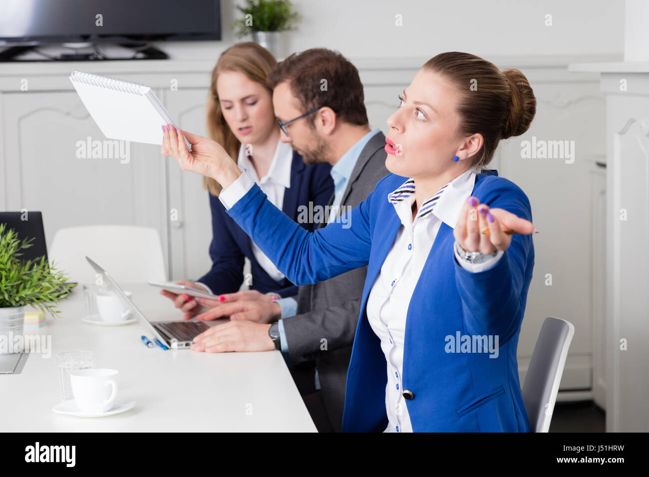 Businesswoman expressing disagreement on a business meeting - Stock Image