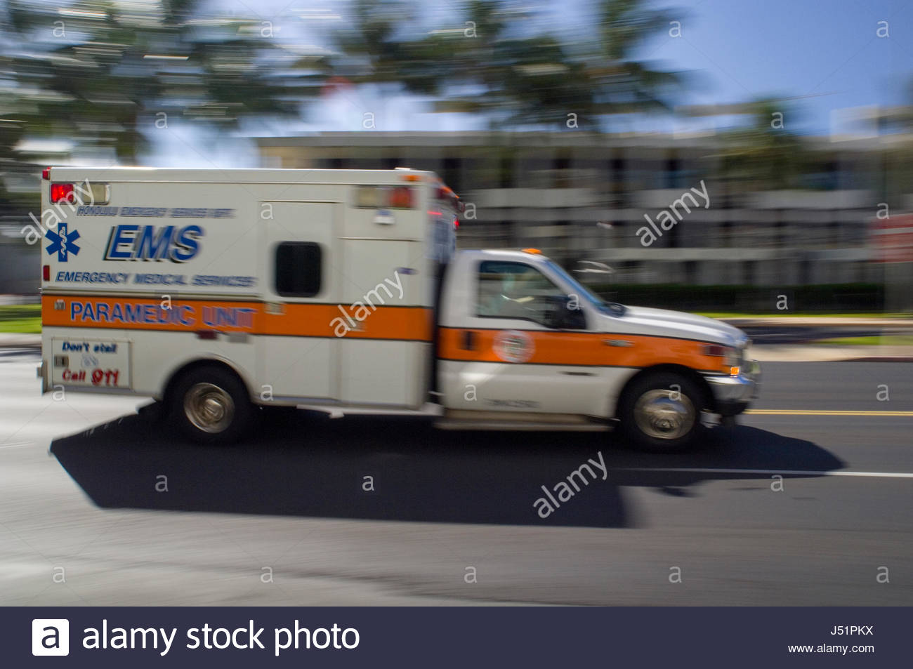 EMS ambulance racing with lights flashing and siren blaring