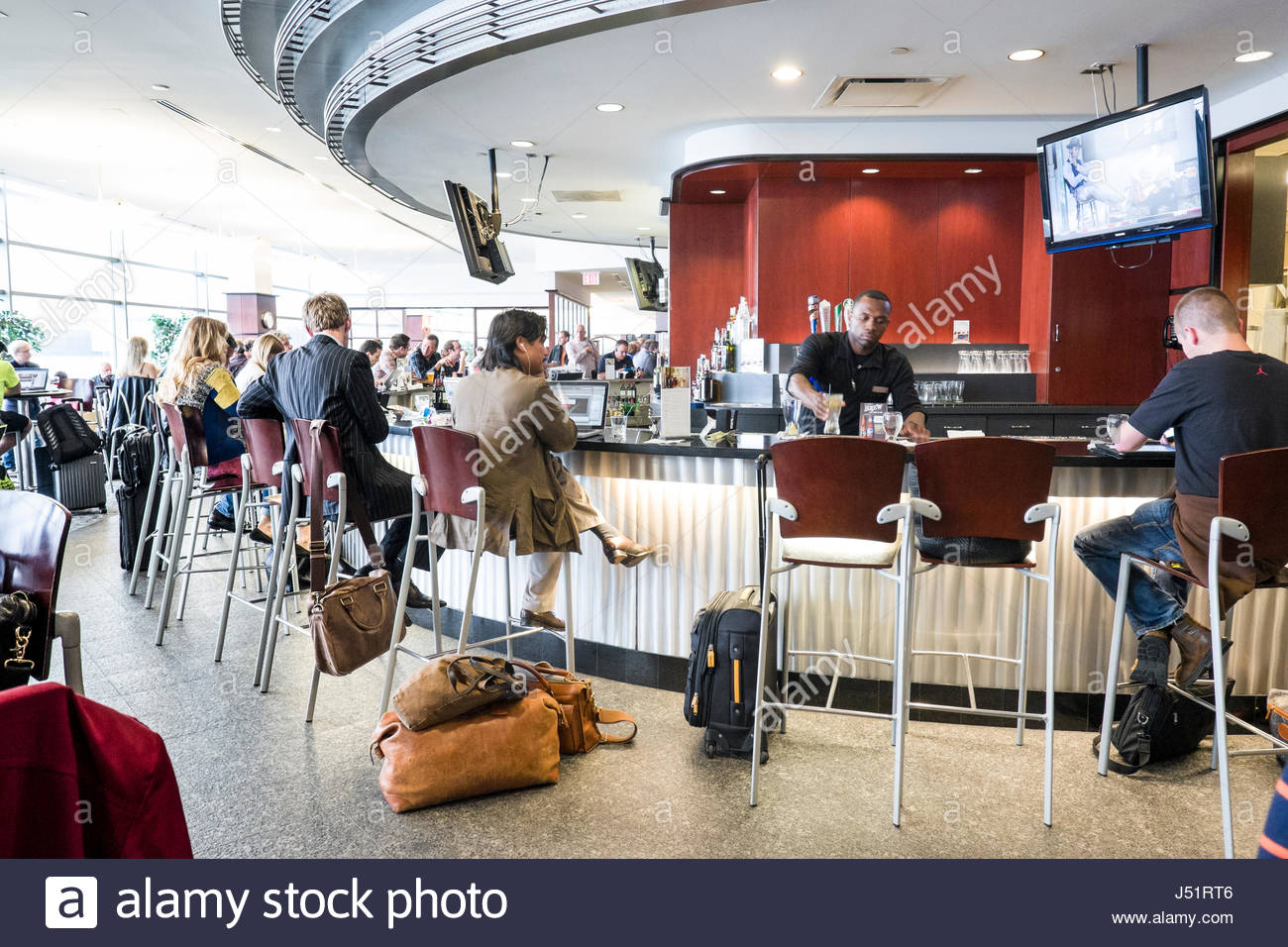 People Sitting At The Bar Inside The United Club Terminal C Newark