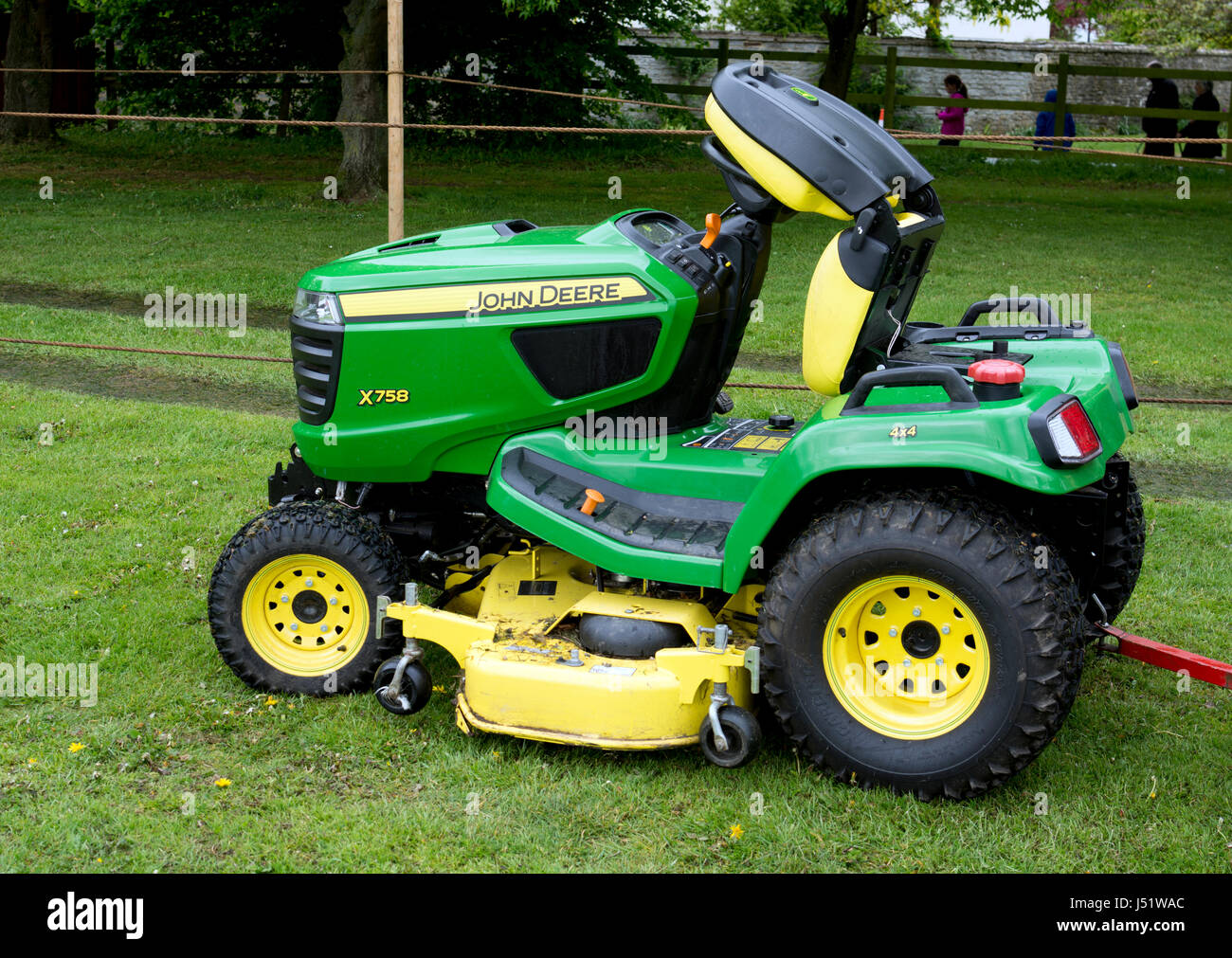 A John Deere ride-on mower - Stock Image