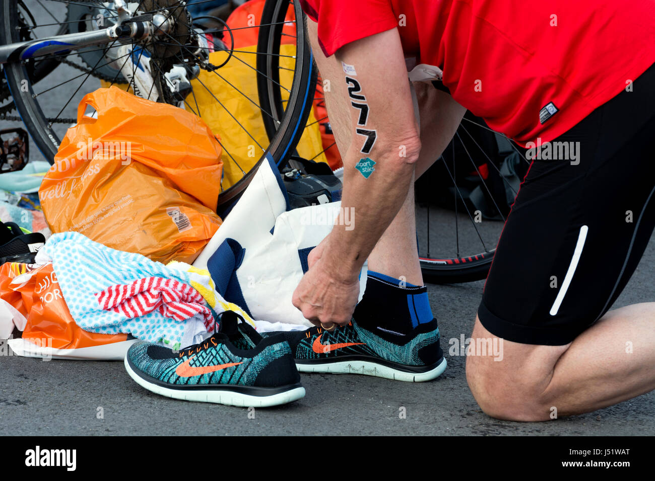 8e2b187237bc9 Male competitor putting on Nike running shoes