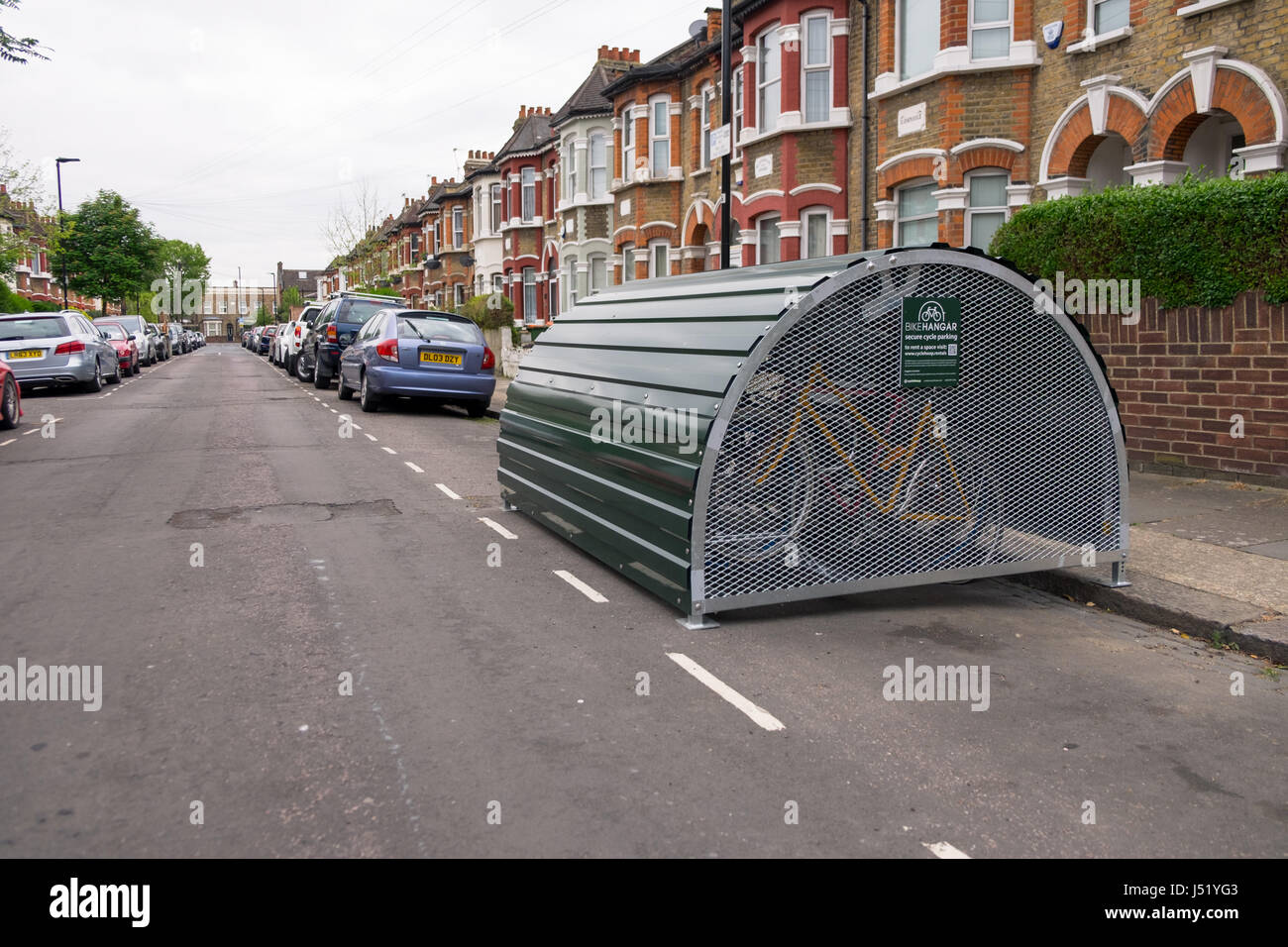 Bikehangar situated on a public road secure cycle parking on a uk urban london street - Stock Image
