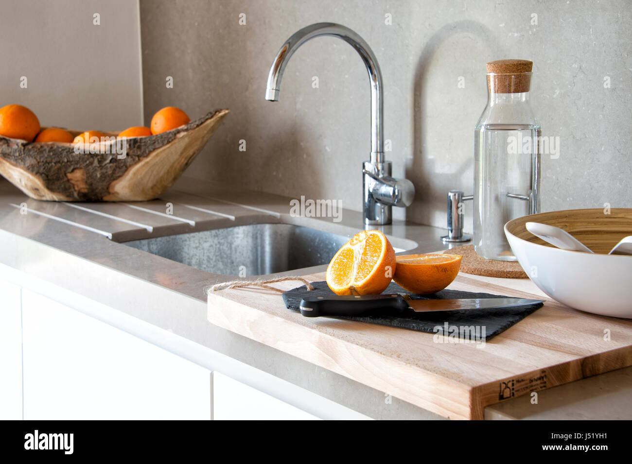 modern kitchen sink with cutting board Stock Photo ...