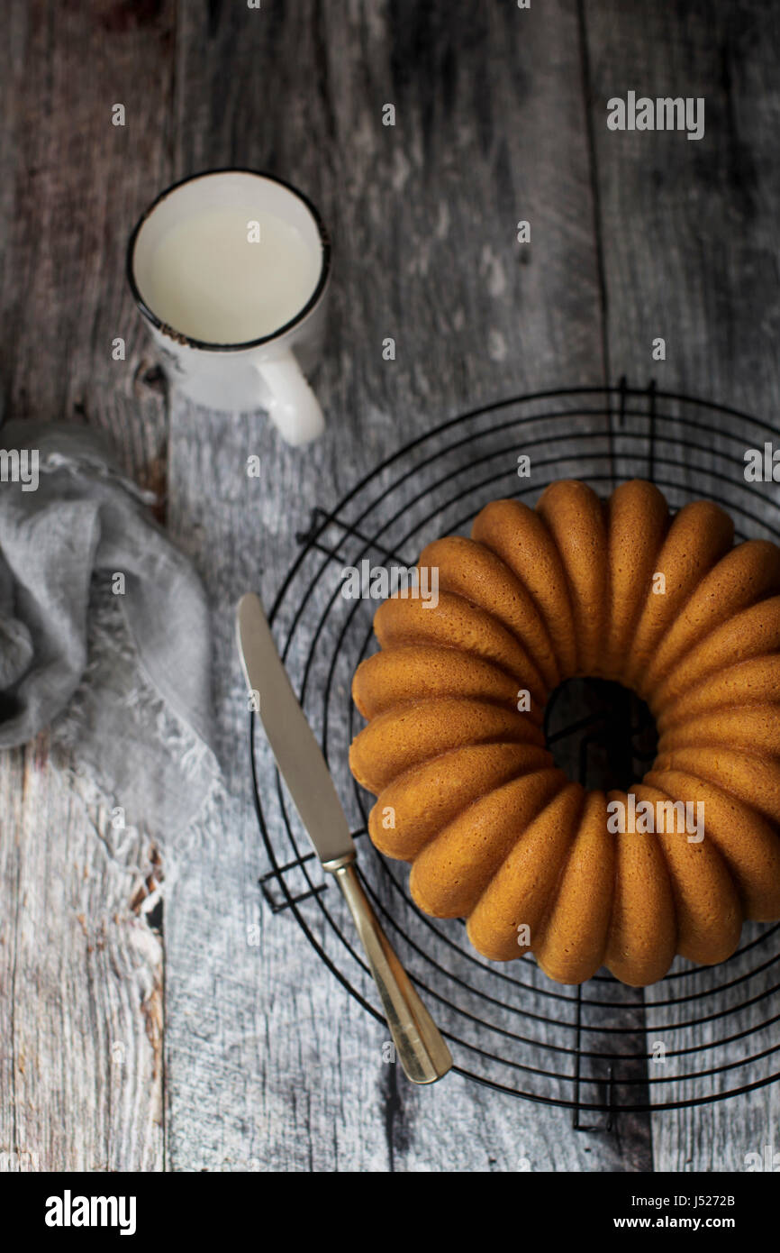 Soft and delicious bundt cake with a golden velvety crumb. - Stock Image