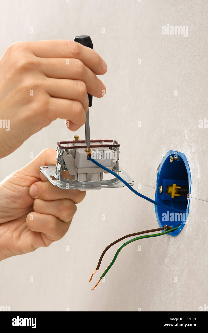 closeup of installing light switch with screwdriver Stock Photo ...