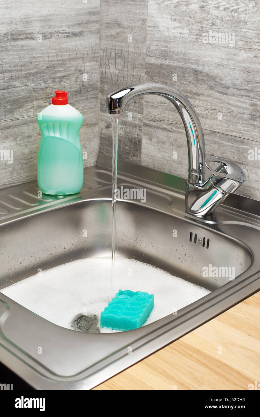 Close Up Of Kitchen Sink Full Of Foam With Running Tap Water Green Stock Photo Alamy