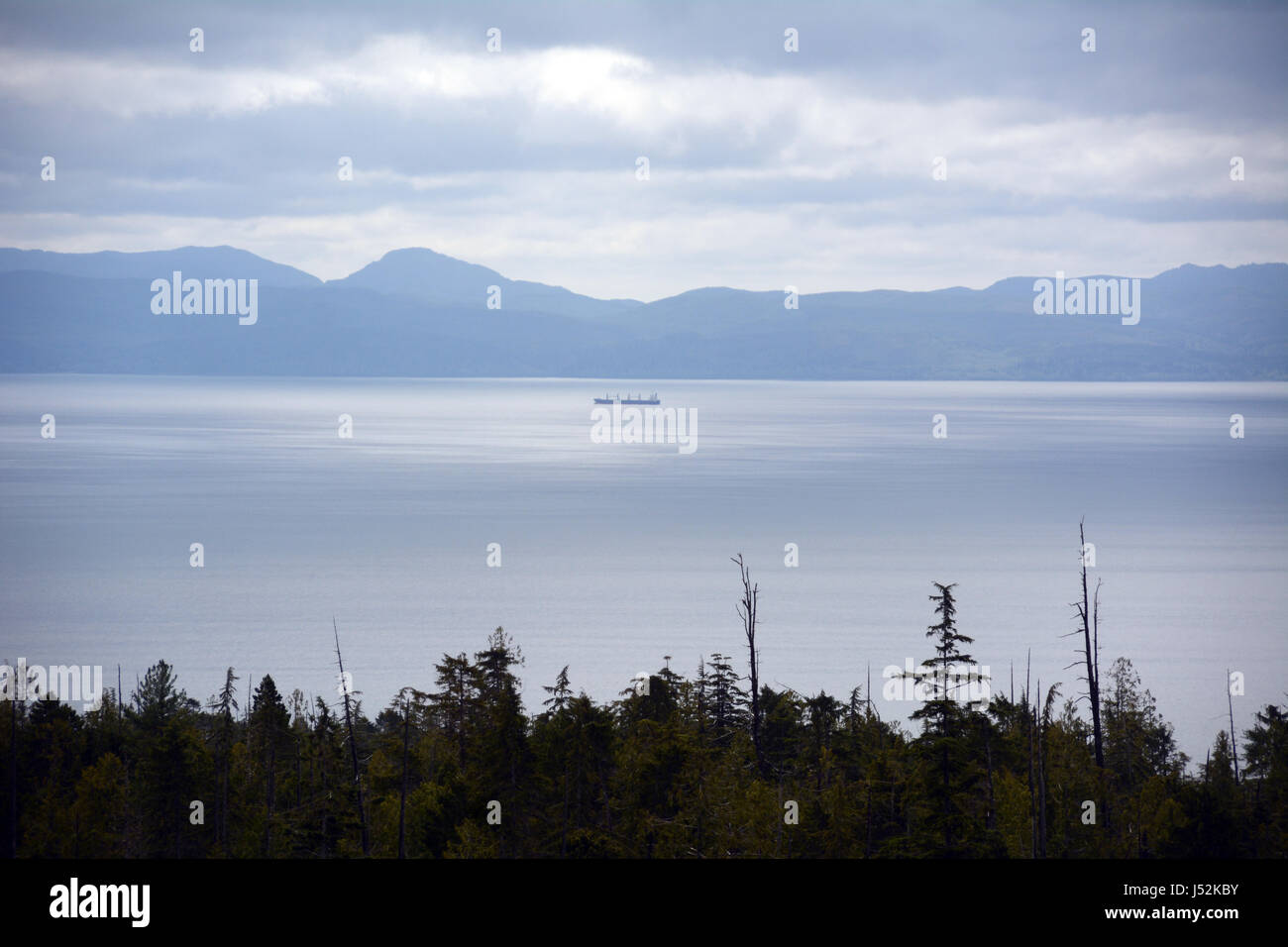 A tanker plies the waters of the Strait of Juan de Fuca between Washington State, United States, and Vancouver Island, - Stock Image