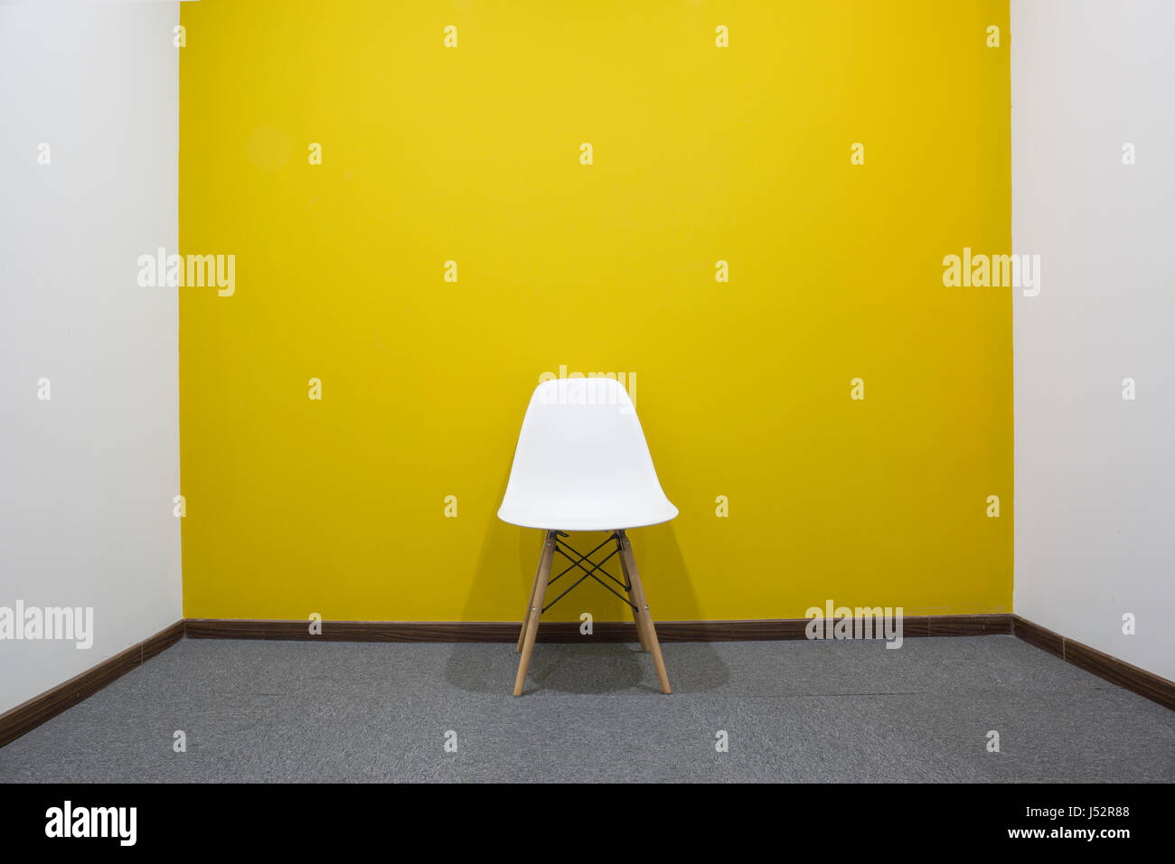 One white chair with yellow wall in meeting room Stock Photo ...