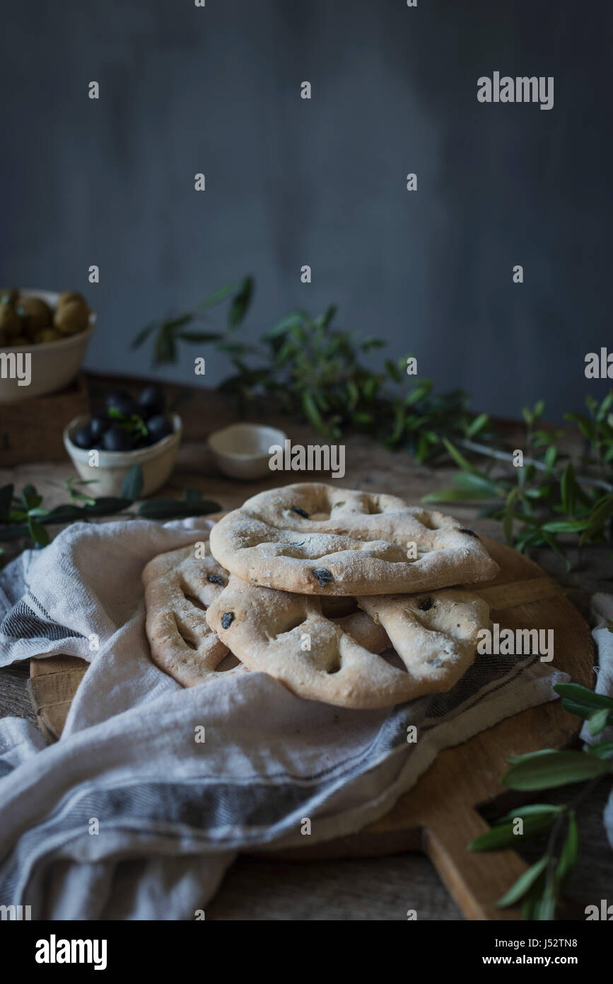Fougasse French bread on a rustic background - Stock Image