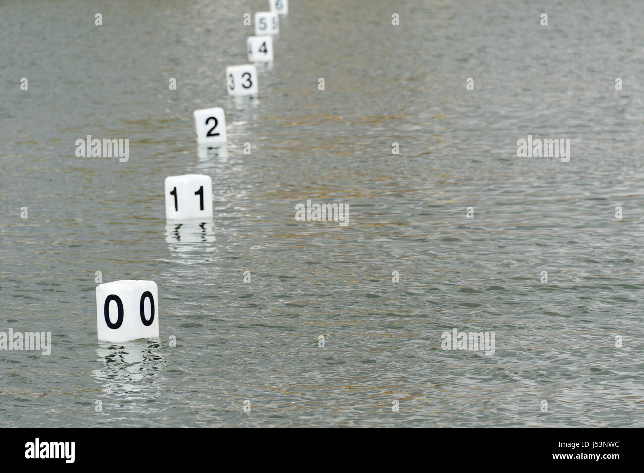 Regatta white buoys showing numbers starting at 0 - Stock Image