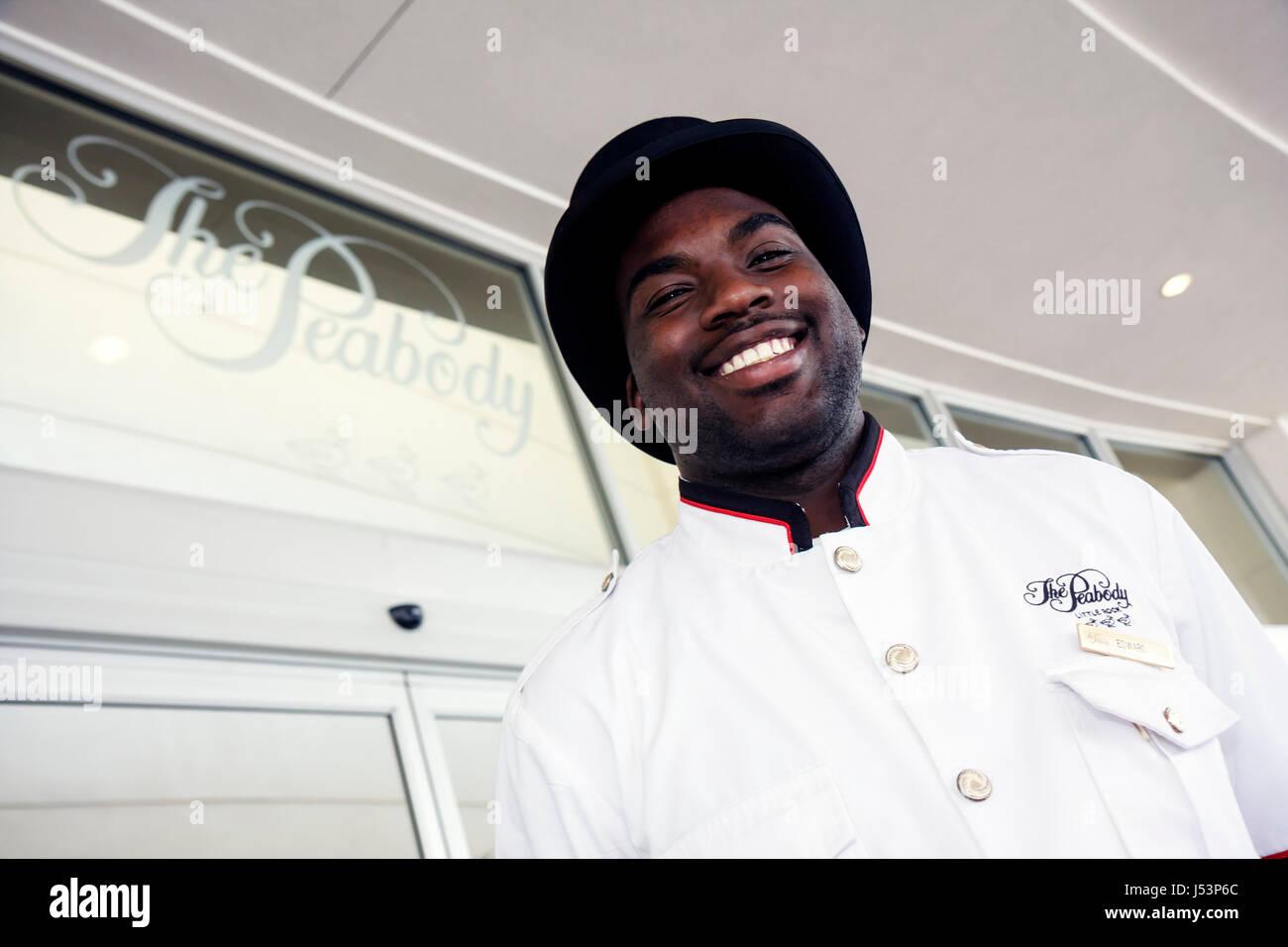 Little Rock Arkansas The Peabody Little Rock hotel Black man porter bellman work job staff door greet customer service - Stock Image