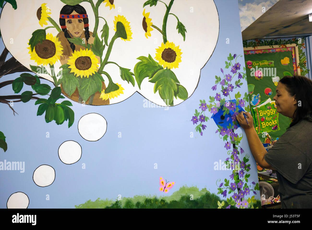 Arkansas Pocahontas Randolph County Library muralist painter Black woman artist youth children's room Native American Stock Photo
